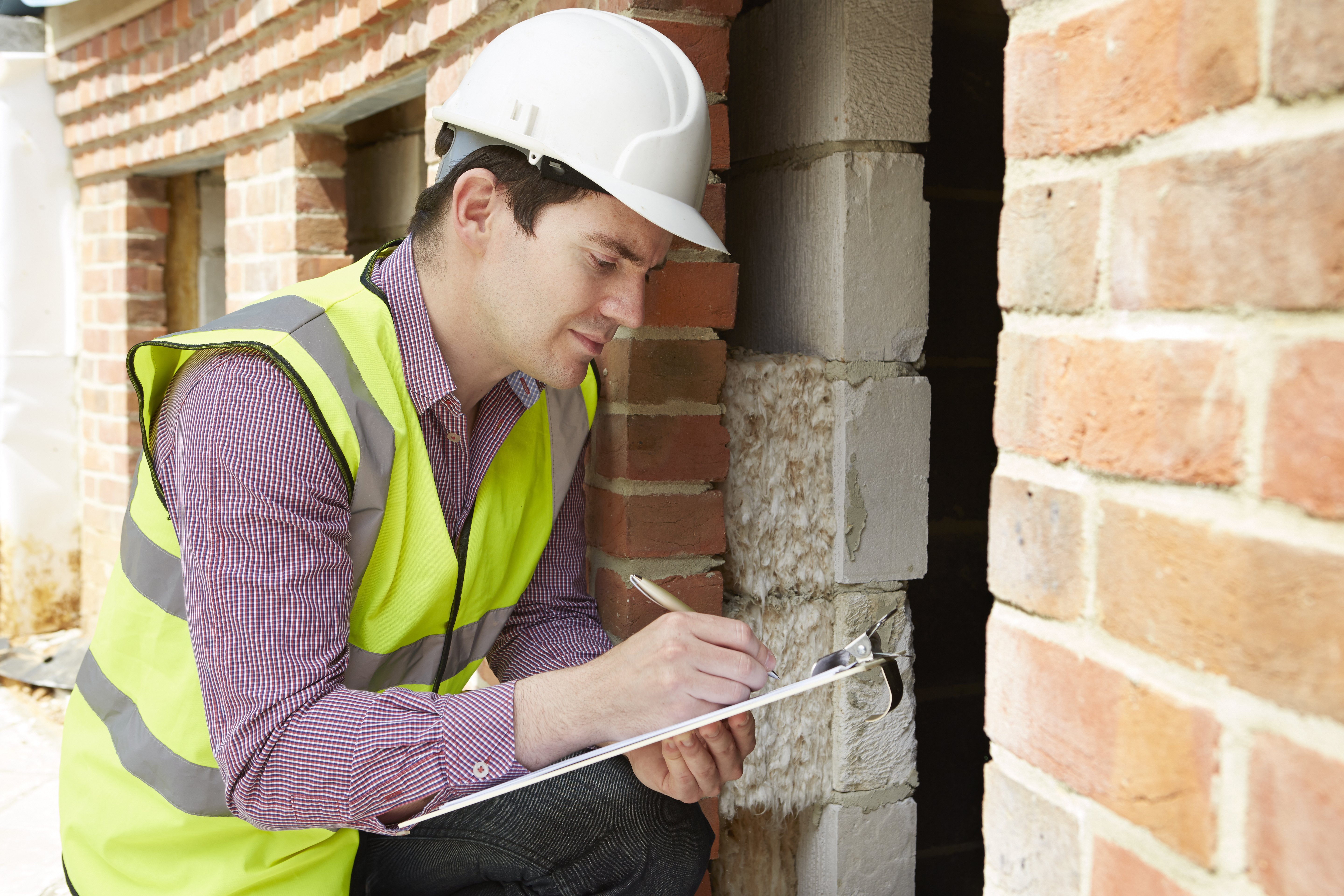 Insurance Adjuster Inspects Home During Appraisal
