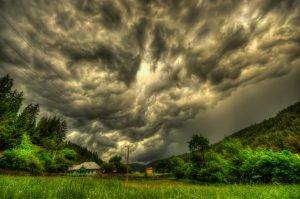 Storm Looms Over House with AAA Insurance